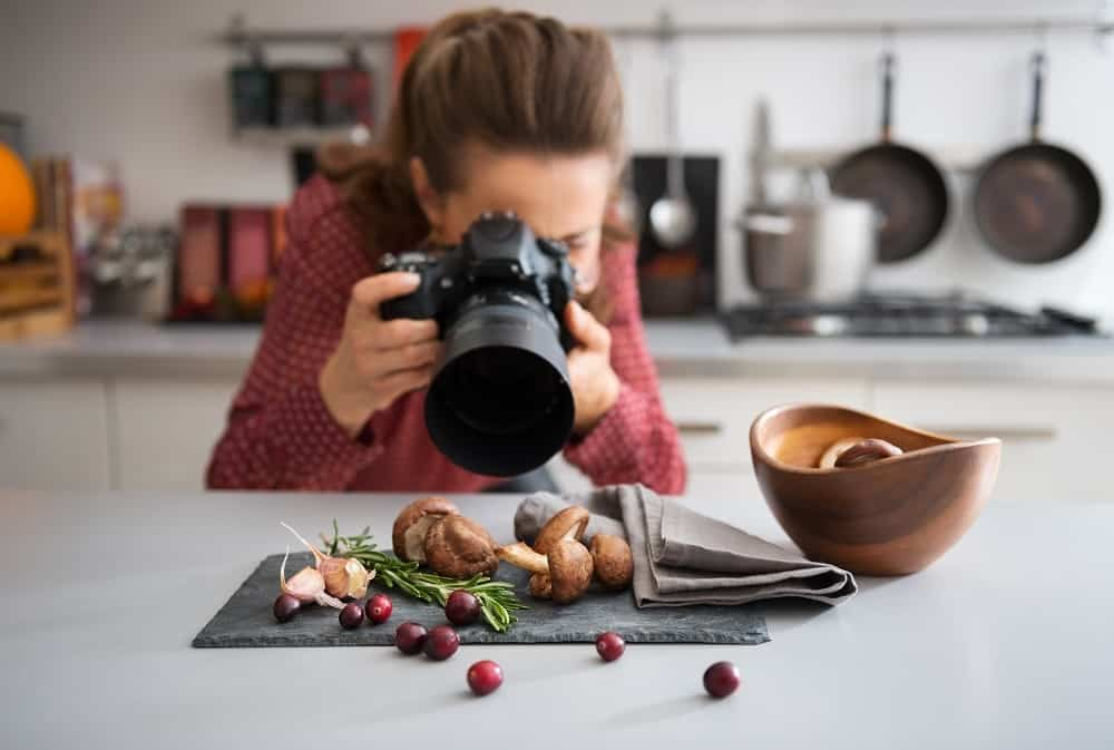 Blogger taking photos of mushrooms and cranberries